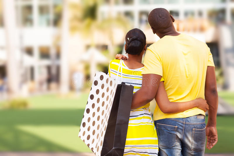 African couple buying apartment stock images