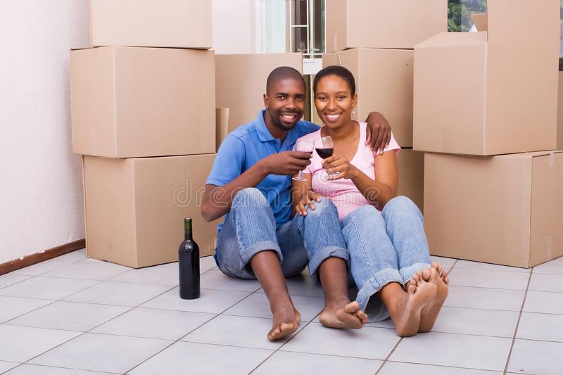 African couple celebrating new home stock images