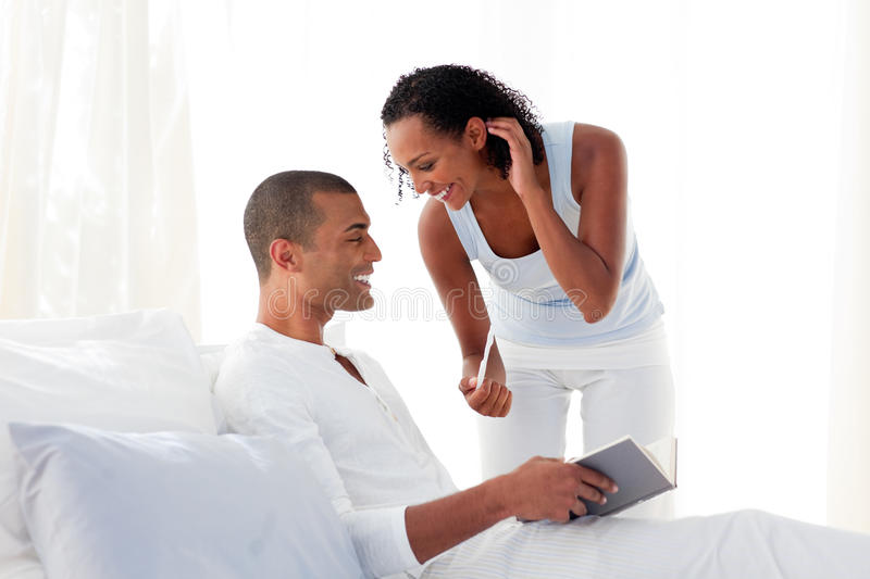 African couple finding results of a pregnancy test stock image