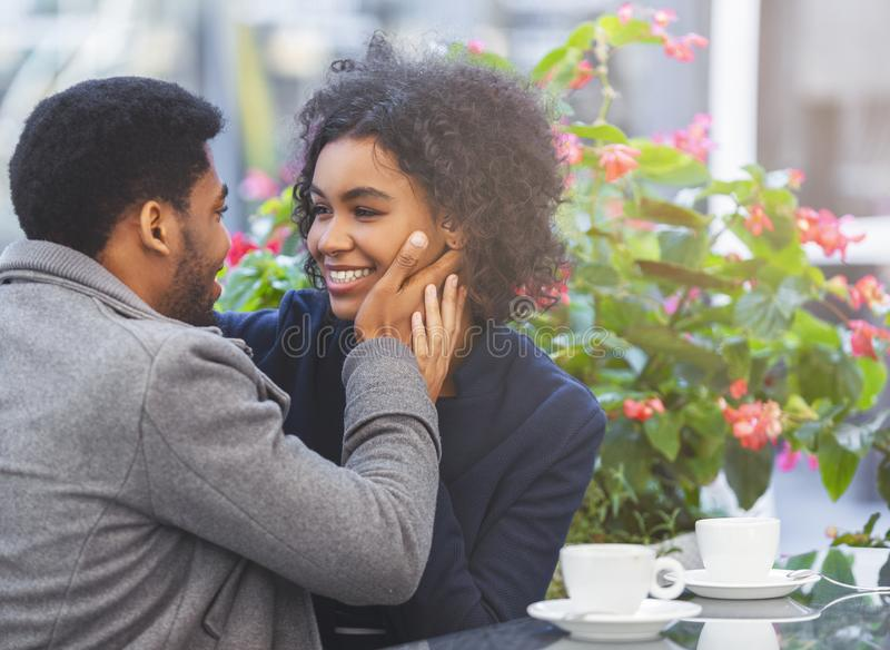 African couple in love telling each other words of love stock images