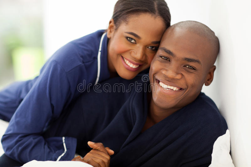 African couple nightwear stock photography