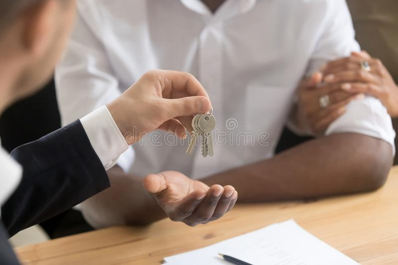 African couple owners get keys to new house from realtor stock images