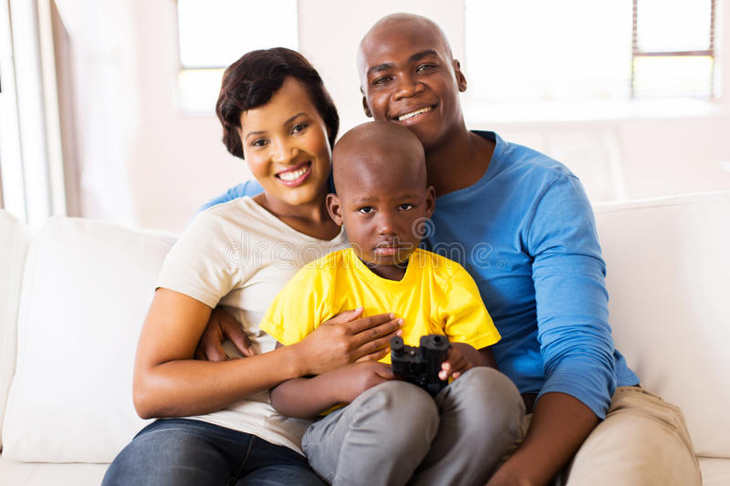African couple and son. Beautiful african couple and son at home stock image