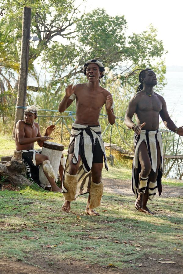 Dancers at a boat launch. African dancers by a boat launch on the Zambezi River in Victoria Falls, Zimbabwe stock photography