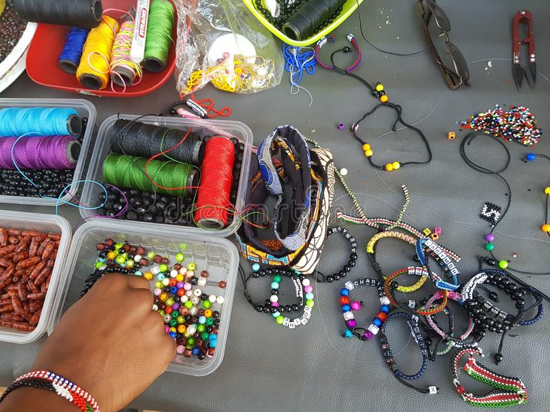 African decoration beads and accessories in different colors. These beads are common in Kenya among the Maasai tribe and are often used to make fashion stock photography