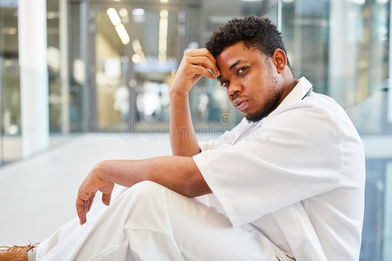 African doctor exhausted and stressed stock images