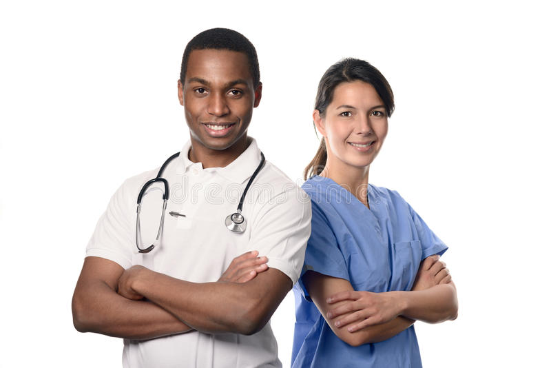 African doctor with a smiling nurse. African doctor with a smiling happy Caucasian nurse or medical colleague standing back to back with folded arms isolated on stock images