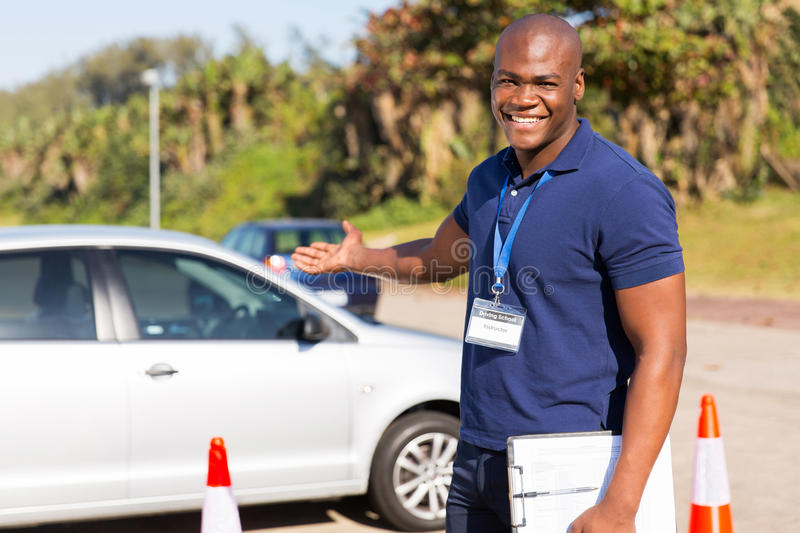 African driving instructor royalty free stock photography