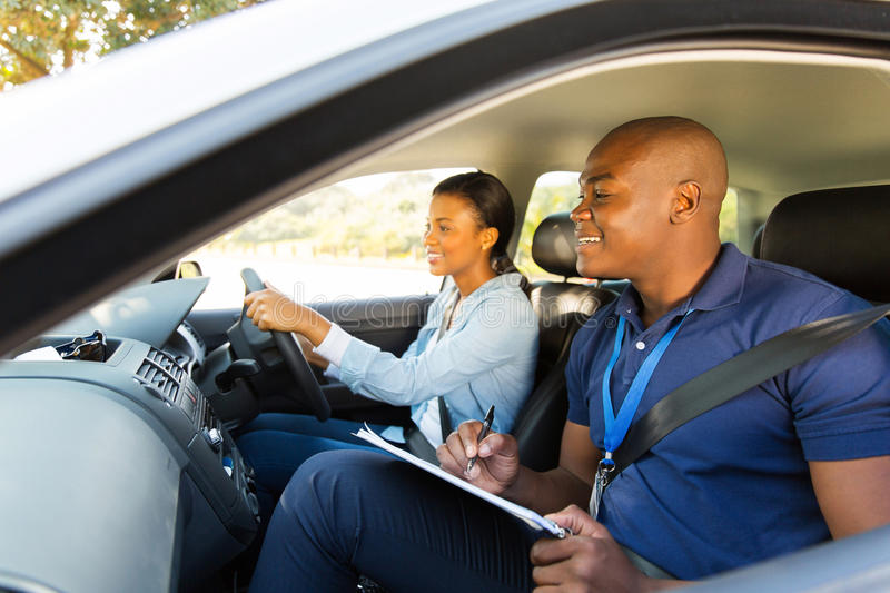 African driving instructor stock photography