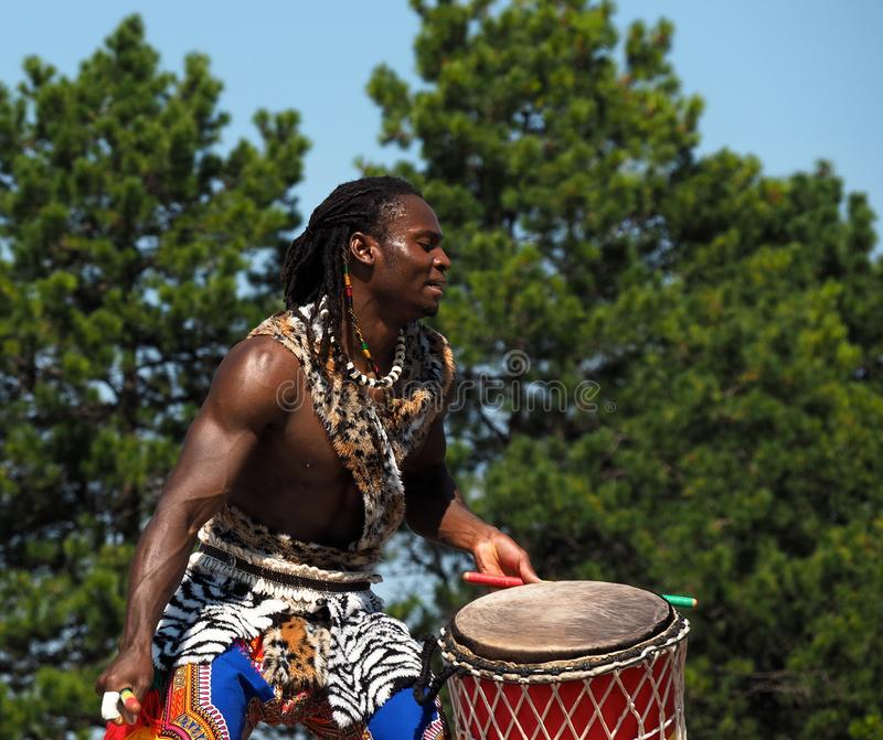 African Drummer In Traditional Dress stock image