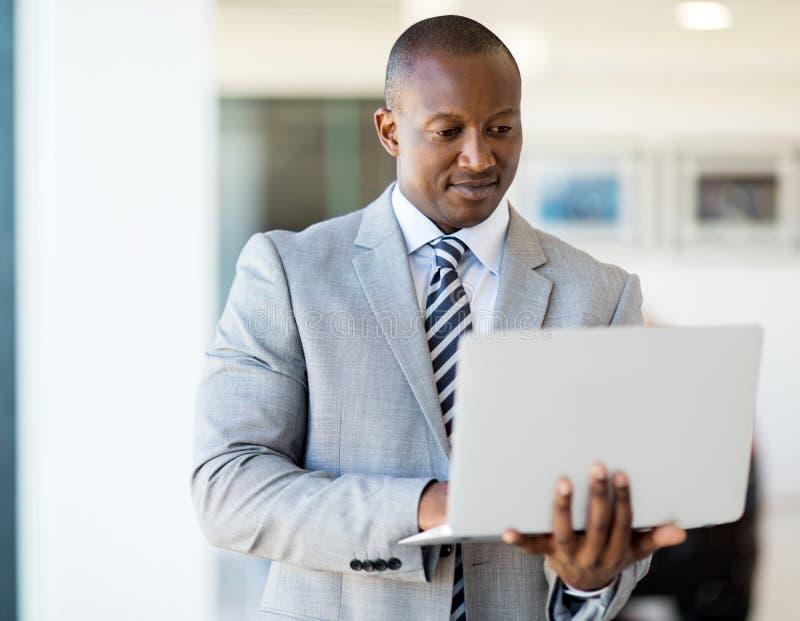 African entrepreneur laptop computer. Successful african entrepreneur working on laptop computer stock photos