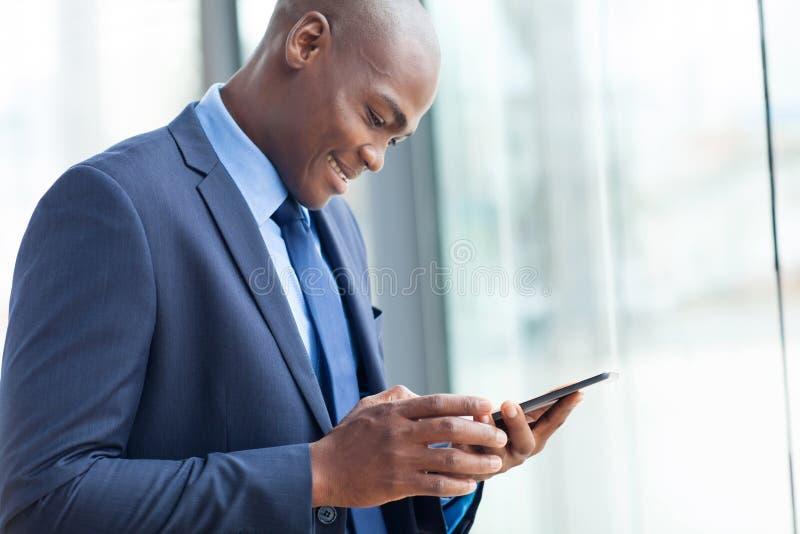 African entrepreneur tablet stock image