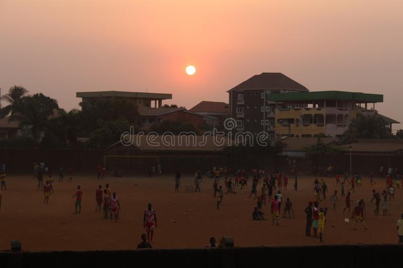 Sunset and football royalty free stock image