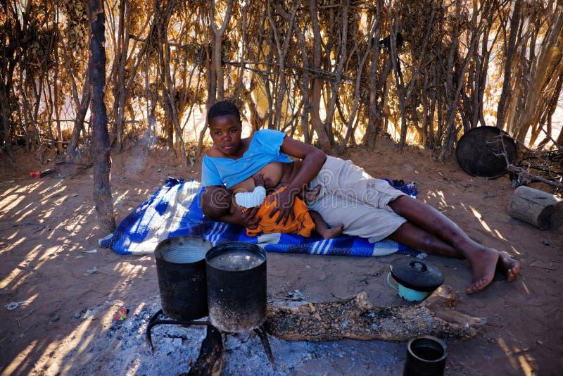 African family. African mother feeding the baby , location Mankodi village , Botswana stock photos