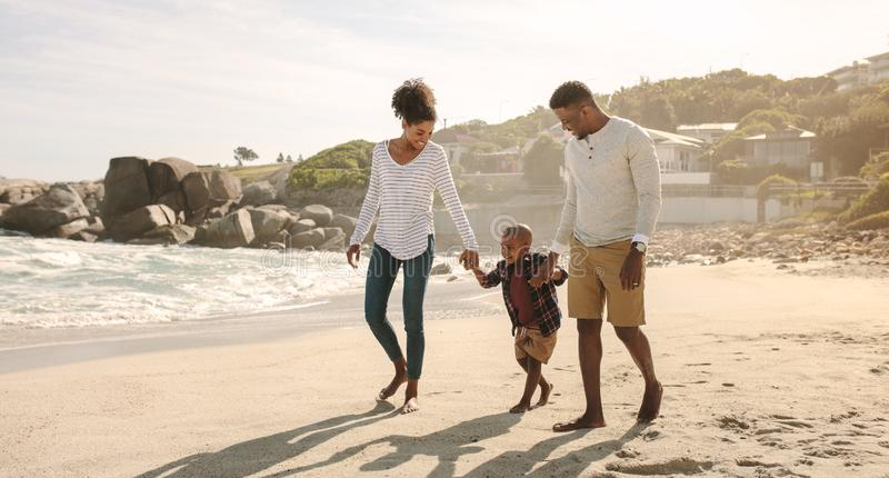 African family on beach walk royalty free stock images