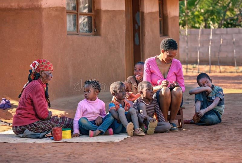 African family in front of the house stock images