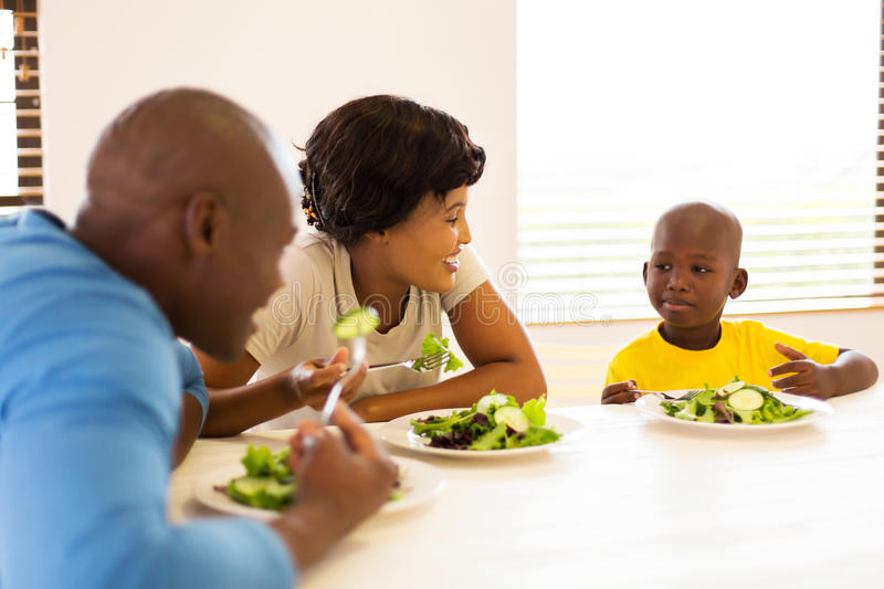 African family healthy meal. Beautiful african family enjoying a healthy meal together at home royalty free stock photo