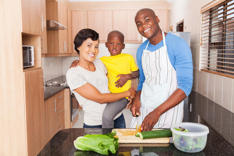 African family preparing lunch. At home in the kitchen royalty free stock images
