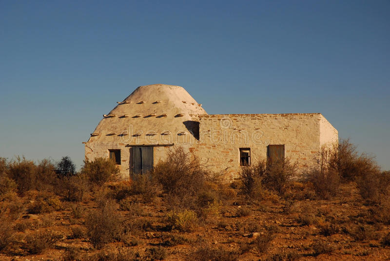 African farm house. A traditional Corbee (primitive old farm house for shepherds), a national treasure in the Great Karoo desert, Northern Cape, South Africa stock image