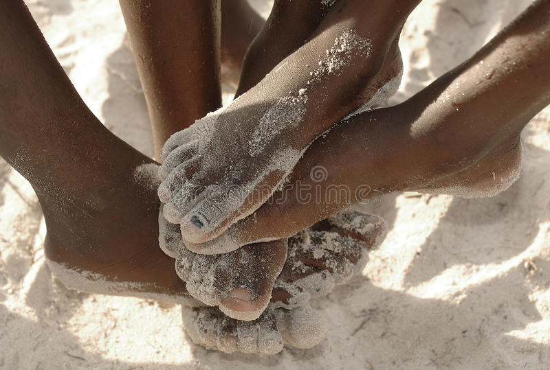 African feet in the sand royalty free stock photography