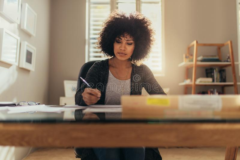 African female architect working at her office royalty free stock photography