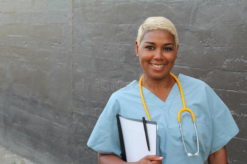 African female doctor isolated on gray stock photos