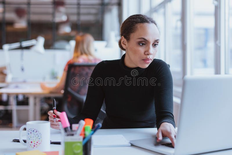 African female executive at work royalty free stock image