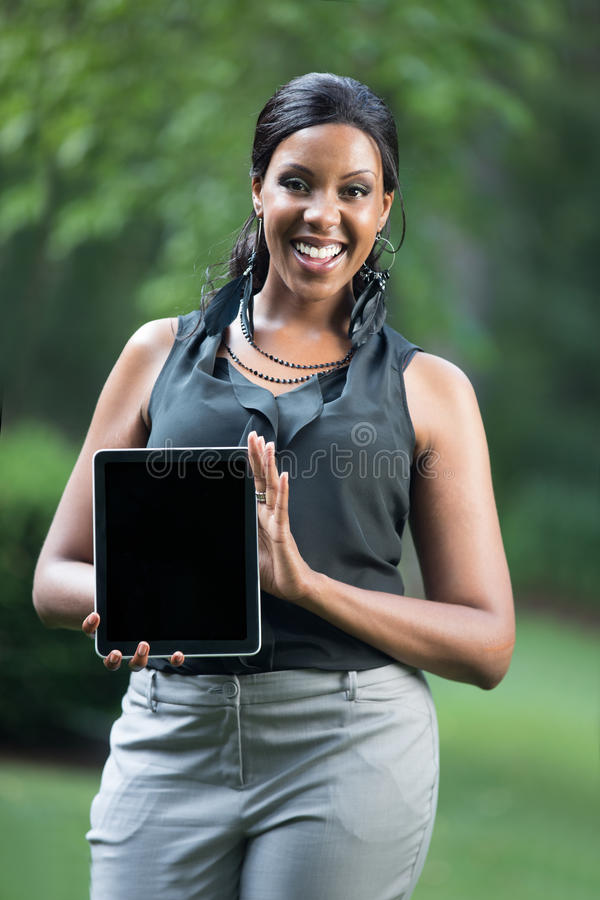 African Female Holding A Touch Pad Tablet PC Stock Images