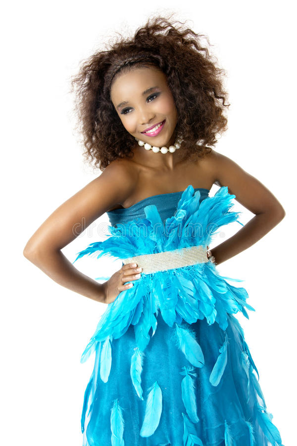 African Female Model Wearing Turquoise Feathered Dress, Big Afro royalty free stock photo