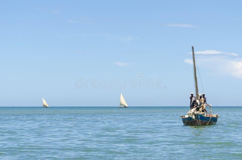 African fishermen dowse sail stock image