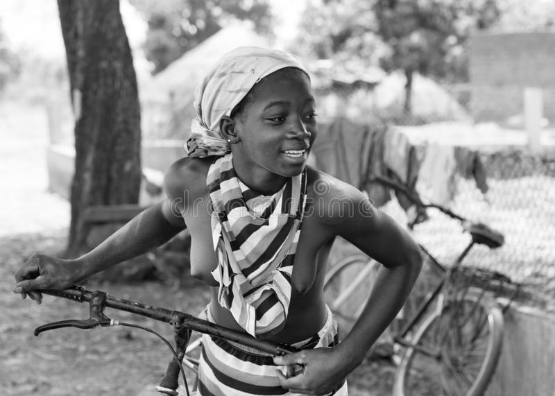 African girl with a bicycle stock photography