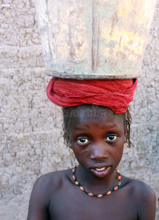 African girl with bucket stock photography