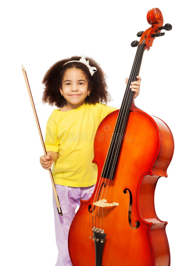 African girl holding cello with fiddlestick. Ready to play standing on the white background royalty free stock photos