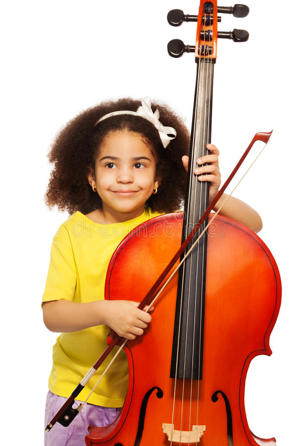 African girl holding violoncello and playing. African girl holding violoncello with fiddlestick ready to play standing on the white background royalty free stock image
