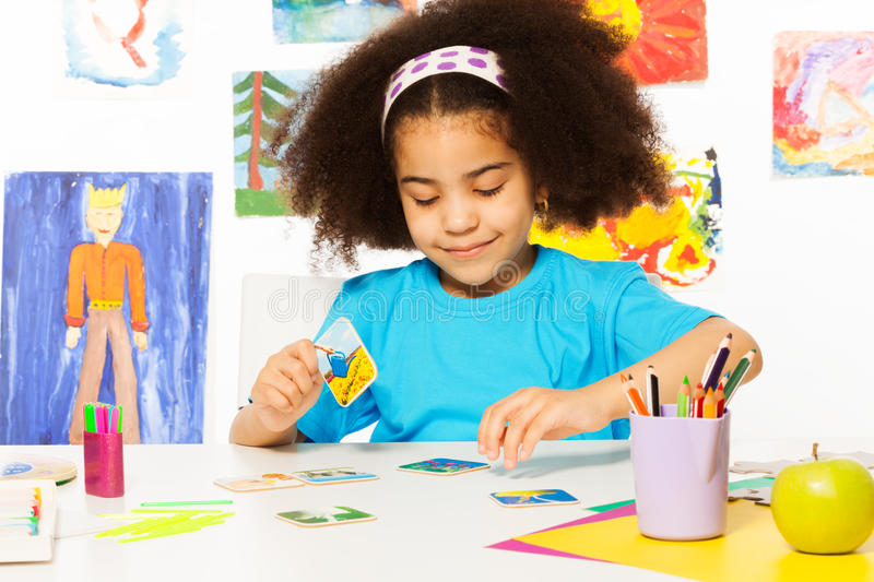African girl match cards during developmental game stock images