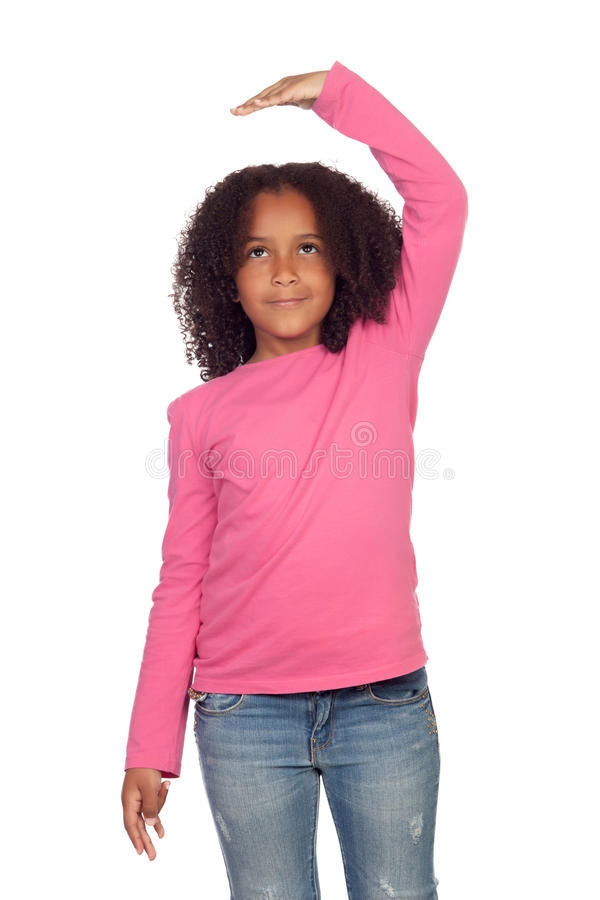 African girl measuring what has grown stock image
