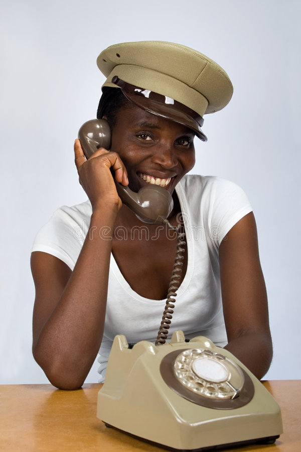 African girl with old phone royalty free stock image