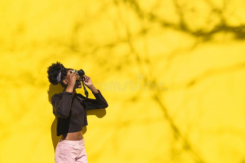 African girl photographer making picture in street royalty free stock images