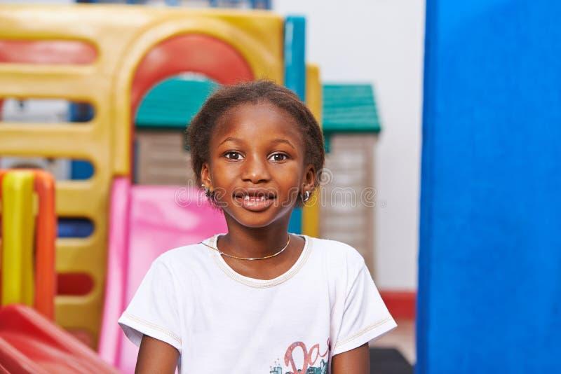 African girl in preschool stock photography