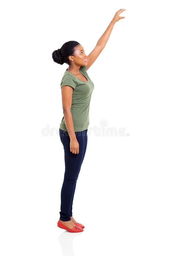 African girl reaching stock photography