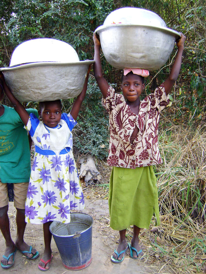African girls taking water - Ghana royalty free stock images