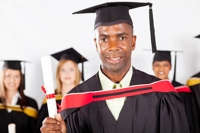 African graduate graduation. Male african graduate at university graduation with classmates royalty free stock photos
