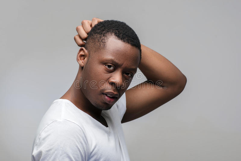 African guy thinking of problems with anxiety stock photos