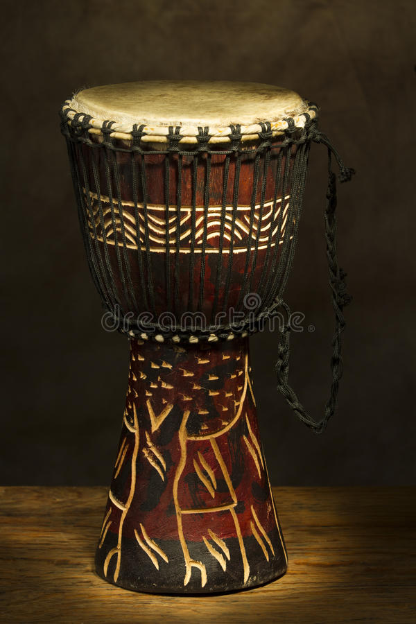 African Hand Drum. Vertical photo of african hand drum painted with light stock photos
