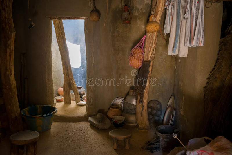 African hut interior. Inside a african hut with pots in the kitchen royalty free stock photos
