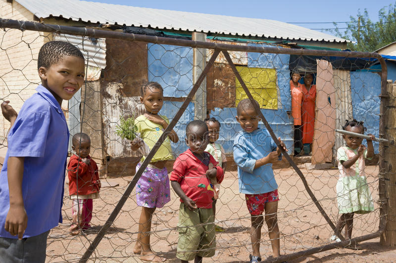 Children behind a fence in Namibia royalty free stock images
