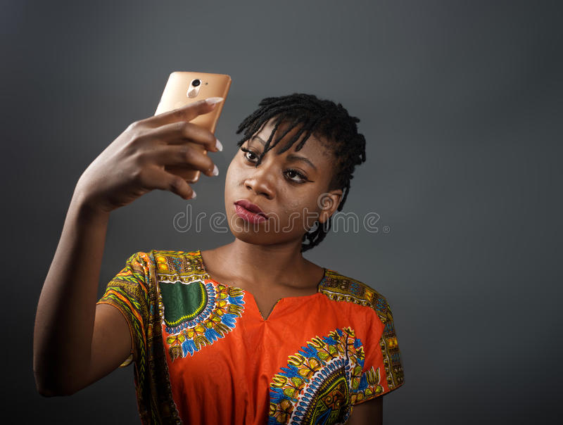 An african lady taking a selfie. A portrait shot of an african lady taking a selfie stock photography