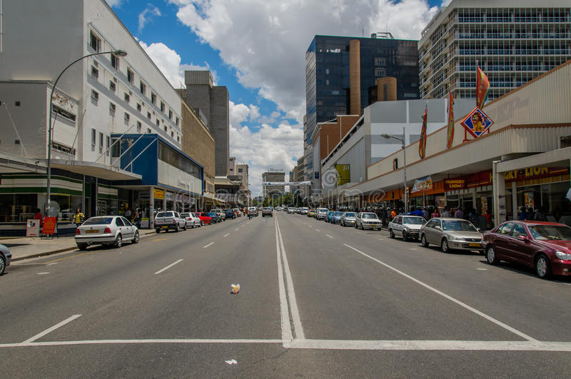 African landscapes - Windhoek Namibia. View of the mainstreet with modern buildings and parked cars against blue cloudy sky at Windhoek, Namibia stock image