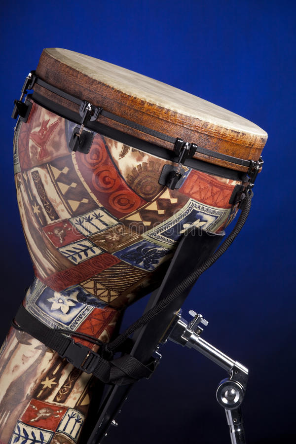Download African Latin Djembe Drum Isolated On Blue Royalty Free Stock Image - Image: 12364546