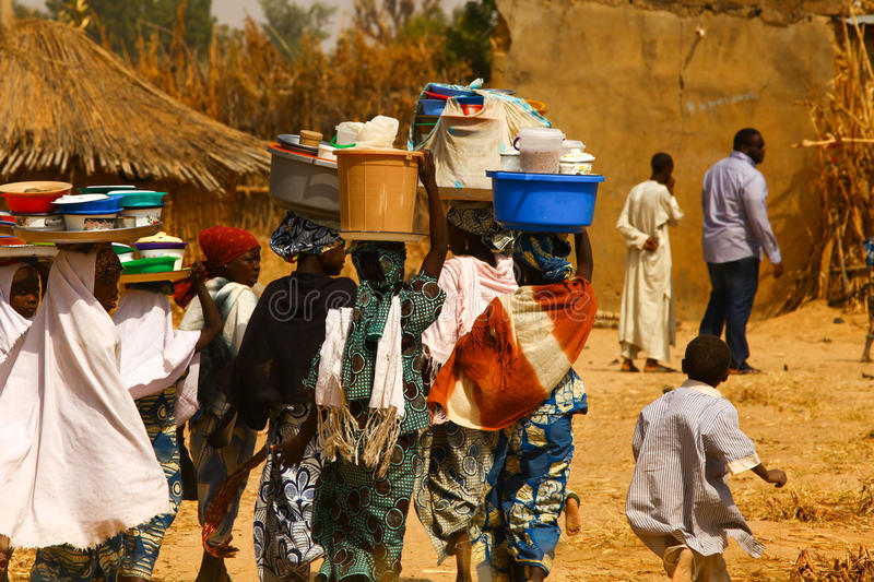 Africans Carrying Goods stock photo
